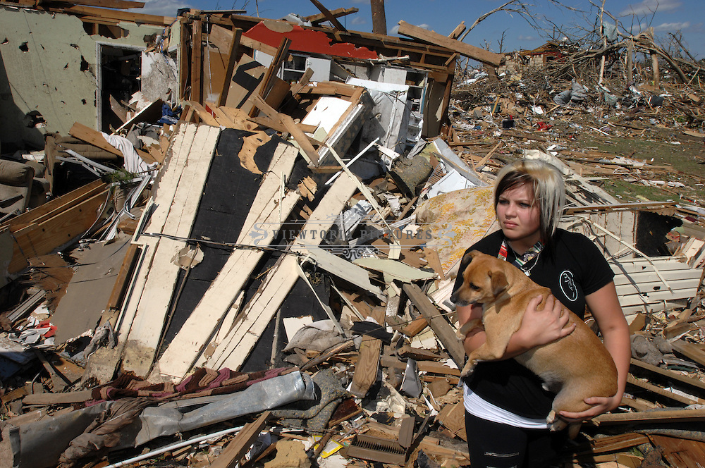 Jamie Schatz carries a dog she rescued out of a friend's basement while surveying tornado damage in Pleasant Grove, Alabama, Thursday, April 28, 2011aerial photograph of tornado damage in , Alabama, Friday, April 29, 2011 Tornado Damage in Alabama 2011