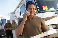 Salesperson on Cell Phone while Couple Shops for an RV