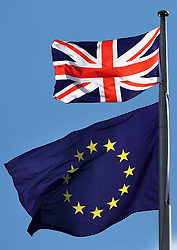 """File photo dated 31/3/2017 of the Union flag and the EU flag. The European Union has """"far more to lose"""" from a """"no deal"""" with the UK in its forthcoming Brexit negotiations compared to a """"no deal"""" with Greece, a British policy think tank report has suggested."""