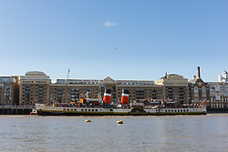 © Licensed to London News Pictures. 30/09/2016. LONDON, UK.  Tourists enjoy the sunny autumn weather on Paddle Steamer Waverley (PS Waverley) as she passes Butlers Wharf after steaming under a raised Tower Bridge on the River Thames this morning. The Waverley, built in the Clyde, Scotland in 1956, is the world's last remaining seagoing paddle steamer in the world and is visiting London for her 70th anniversary since she was first launched. Photo credit: Vickie Flores/LNP