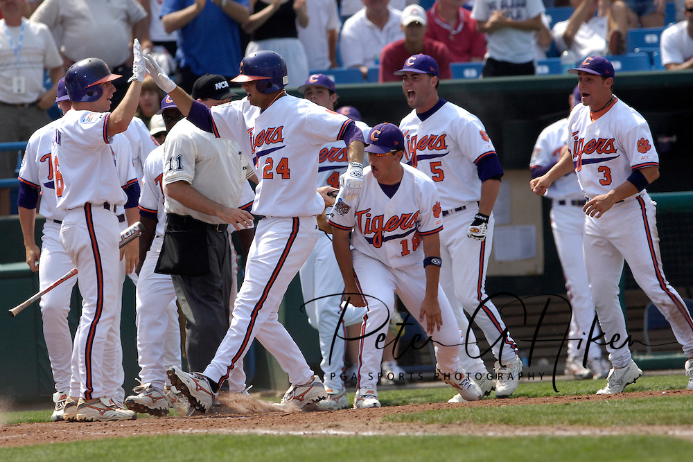 Clemson's Andy D'Alessio (24) celebrates with his teammates, after hitting a three run homer in the bottom of the eighth inning, to give the Tigers a 6-4 lead over Georgia Tech.  The Clemson Tigers came from behind to score eight runs in the eighth inning and defeat Georgia Tech 8-4 in the first game of the College World Series at Rosenbaltt Stadium in Omaha, Nebraska, June 16, 2006.