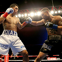 VERONA, NY - JUNE 09:  Regis Prograis (R) punches Joel Diaz Jr. during a ShoBox boxing match at the Turning Stone Resort Casino on June 9, 2017 in Verona, New York. (Photo by Alex Menendez/Getty Images) *** Local Caption *** Regis Prograis; <br /> Joel Diaz Jr.
