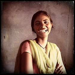 "iPhone portrait of Laali Bairwa, 15, in a village outside of Tonk, Rajasthan, India, April 3, 2013. ""My circumstances were such that my mother had passed away and there was no one to do the work. So I complied and thought, 'Alright I will not study, my life is ruined.' Then I went to my father in tears saying, 'Please, I will do the work and study  at the same time.' I said to my father, 'Do not get me married. I do not want to marry. I want to study. If you want to educate me, then do it, or I will study on my own.' If I can say no to my father, then even you can say no,"" said Bairwa. <br /> <br /> Under Indian law, children younger than 18 cannot marry. Yet in a number of India's states, at least half of all girls are married before they turn 18, according to statistics gathered in 2012 by the United Nations Population Fund (UNFPA). However, young girls in the Indian state of Rajasthan—and even a few boys—are getting some help in combatting child marriage. In villages throughout Tonk, Jaipur and Banswara districts, the Center for Unfolding Learning Potential, or CULP, uses its Pehchan Project to reach out to girls, generally between the ages of 9 and 14, who either left school early or never went at all. The education and confidence-building CULP offers have empowered youngsters to refuse forced marriages in favor of continuing their studies, and the nongovernmental organization has provided them with resources and advocates in their fight."