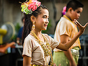 10 SEPTEMBER 2016 - BANGKOK, THAILAND: Children in traditional Thai outfits perform for families at a community party in Pom Mahakan. Forty-four families still live in the Pom Mahakan Fort community. The city of Bangkok has given them provisional permission to stay, but city officials say the permission could be rescinded and the city go ahead with the evictions. The residents of the historic fort have barricaded most of the gates into the fort and are joined every day by community activists from around Bangkok who support their efforts to stay.                PHOTO BY JACK KURTZ