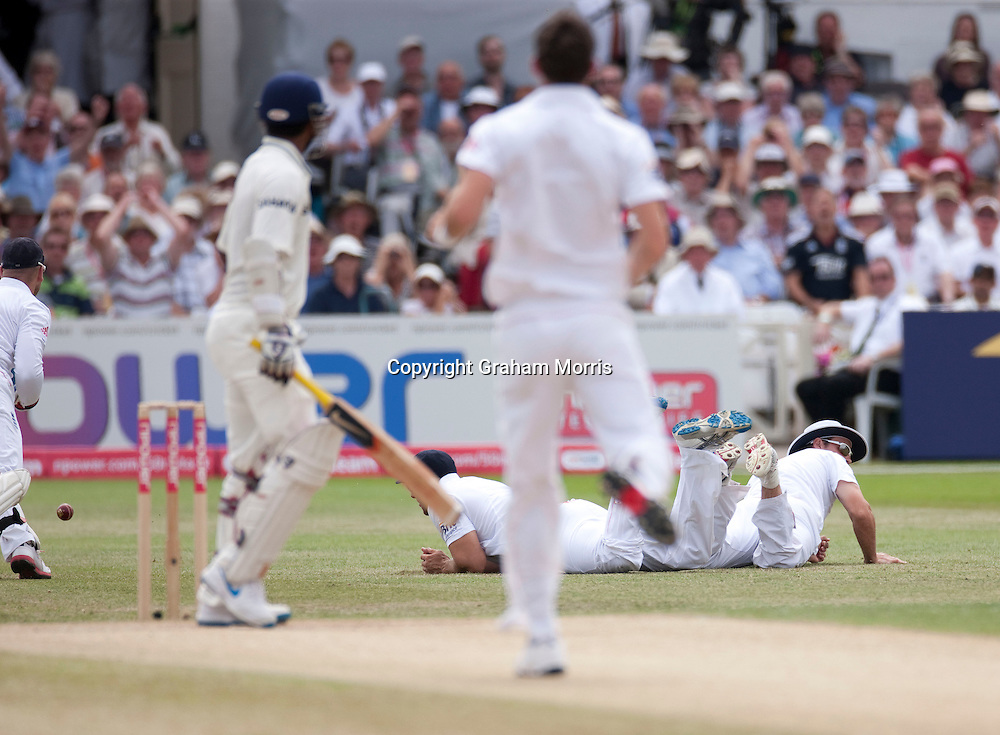 Tim Bresnan and Andrew Strauss down after Abhinav Mukund is dropped first ball off James Anderson during the second npower Test Match between England and India at Trent Bridge, Nottingham.  Photo: Graham Morris (Tel: +44(0)20 8969 4192 Email: sales@cricketpix.com) 01/08/11