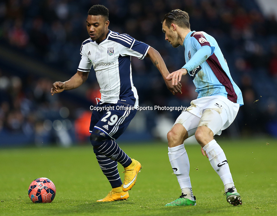 3rd January 2015 - FA Cup 3rd Round - West Bromwich Albion v Gateshead - Stephane Sessegon of West Bromwich Albion tries to ghost past John Oster of Gateshead - Photo: Paul Roberts / Offside.