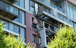 © Licensed to London News Pictures. 27/06/2018. London, UK. Fire damage is seen on flats on Queenstown Road, South London currently being attended by 58 firefighters. The fire is reported to have started on a third floor balcony before working its way up the outside of the building. Photo credit: Peter Macdiarmid/LNP