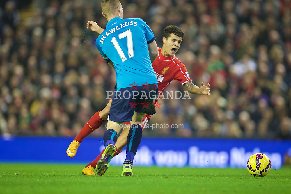 LIVERPOOL, ENGLAND - Saturday, November 29, 2014: Liverpool's Philippe Coutinho Correia is fouled by Stoke City's captain Ryan Shawcross during the Premier League match at Anfield. (Pic by David Rawcliffe/Propaganda)