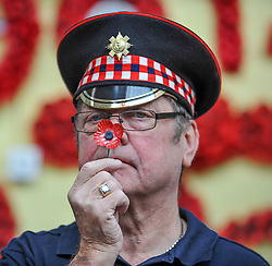 Worker Arthur Dyke from the Poppy Scotland workshop in Edinburgh checks over the specially designed centenary poppy, to mark 100 years since the end of the First World War.<br /> <br /> © Dave Johnston/ EEm