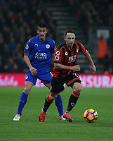 Football - 2016 / 2017 Premier League - AFC Bournemouth vs. Leicester City<br /> <br /> Bournemouth's Marc Pugh and Luis Hernandez of Leicester City in action at Dean Court (The Vitality Stadium) Bournemouth<br /> <br /> COLORSPORT/SHAUN BOGGUST
