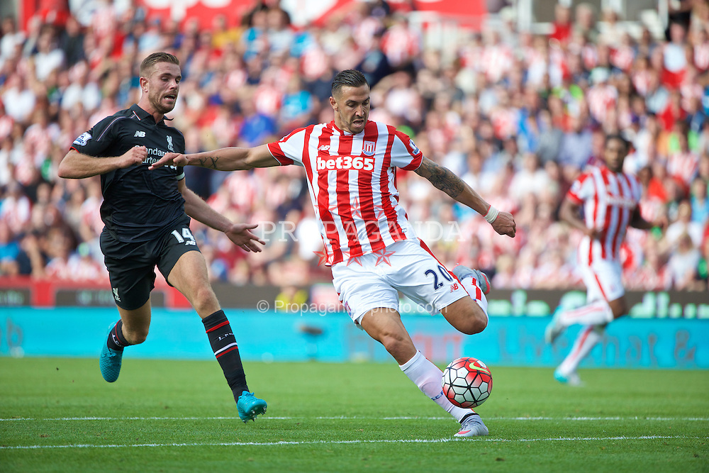 STOKE-ON-TRENT, ENGLAND - Sunday, August 9, 2015: Liverpool's captain Jordan Henderson in action against Stoke City's Geoff Cameron during the Premier League match at the Britannia Stadium. (Pic by David Rawcliffe/Propaganda)