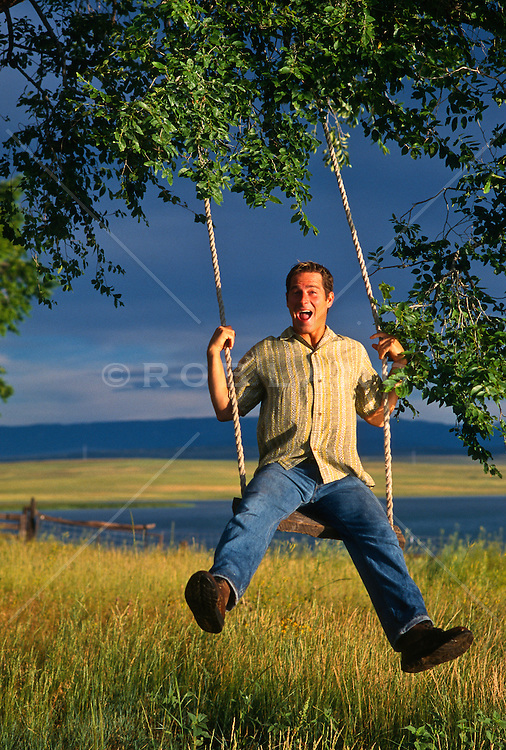Man making a funny face while swinging on a rope swing in New Mexico