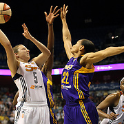 Kelsey Griffin, (left), Connecticut Sun, shoots over Armintie Herrington, Los Angeles Sparks, during the Connecticut Sun Vs Los Angeles Sparks WNBA regular season game at Mohegan Sun Arena, Uncasville, Connecticut, USA. 3rd July 2014. Photo Tim Clayton