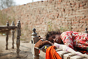 A sick girl lies on a bed outside her house. Most families are free but still too poor to afford even simple medicine. Following the release of the Global Slavery Index by the Walk Free Foundation Pakistan is ranked 3rd worse in the world behind India and China. The Asian Development Bank estimates some 1.8 million people are slaves in Pakistan yet other estimates reach up to 4 million people, most of which toil year after year in brick kilns or sugar cane plantations. Their stories are the same; they have no-where to turn so they borrow money from a land-owner for a medical emergency or marriage dowry. The landlords pay in return for work, their labour supposed to be taken off the amount borrowed. Yet after years of no salary incredibly their amount owed is often quadrupled, the excuse being the amount they cost to feed! Many are chained, abused, raped and even killed.<br /> <br /> For years they had no where to run, no one to help but now a small local NGO called the Green Development Rural Organisation (GDRO) works to free bonded-slaves by using the law against their captives. Yet, often freed slaves end up right back where they were or risk being hunted by the landowner and forced to return. So GRDO started building villages so slaves who escape or are freed have somewhere safe to go. It now has two, whose names translate from Urdu as 'Village of the Freed' and 'Village of the Courageous', and is working on a 3rd. The land is bought and allocated to freed slave families where they can built a house and start again. Without such help the vicious cycle would continue.