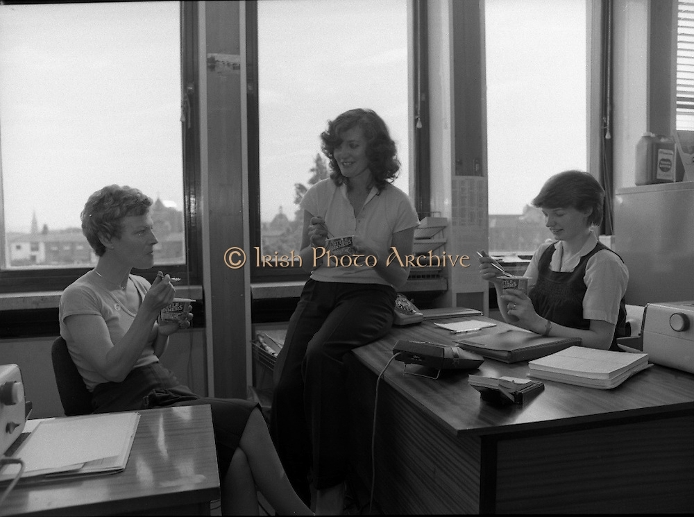 "Erin Foods Promotion.      (N91)..1981..03.09.1981..09.03.1981..3rd September 1981..As part of an advertising campaign to promote Erin Foods ""Little Dinners"", Erin took the promotion nationwide. Here we see three office girls enjoying the ""Little Dinner"" as a tasty snack at lunch time...Image shows three young ladies enjoying a tasty ""Little Dinner""snack at lunch time in their office..If you know these three ladies why not contact us at irishphotoarchive@gmail.com and we will gladly add their names to the image."