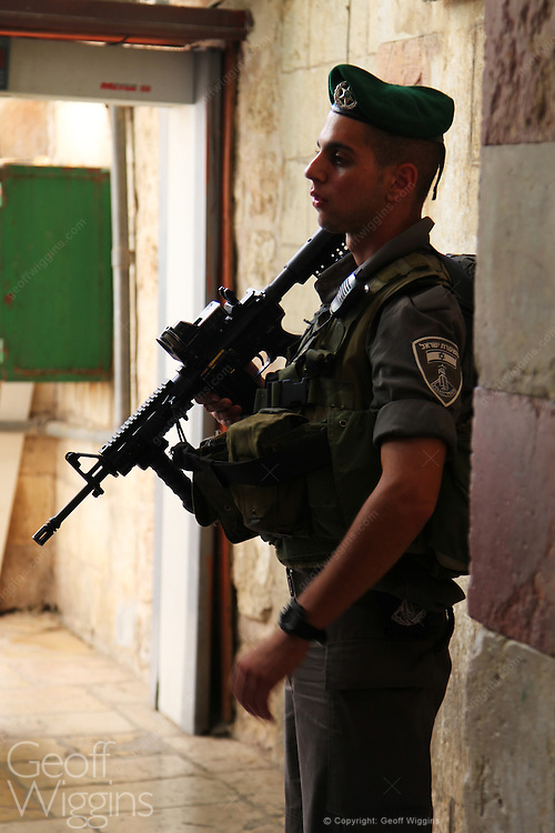One of 5000 Israeli Defense Force soldiers defending 400 illegal Israeli settlers in central Hebron, Palestine Territory Occupied
