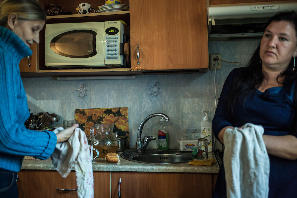 DNIPROPETROVSK, UKRAINE - OCTOBER 12: Svitlana Kostromina (L) in the kitchen at the home of Vira Luchnikova (R), part of her church's congregation, where she, her daughter, and her granddaughter are living after fleeing fighting in Luhansk in Ukraine's East on October 12, 2014 in Dnipropetrovsk, Ukraine. The United Nations has registered more than 360,000 people who have been forced to leave their homes due to fighting in the East, though the true number is believed to be much higher. (Photo by Brendan Hoffman/Getty Images) *** Local Caption *** Svitlana Kostromina;Vira Luchnikova