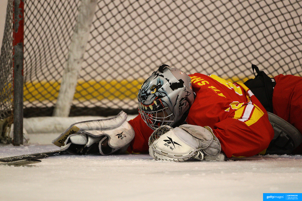 Chinese keeper Xai Shengrong, wearing his cat helmet, lays on the ice after conceding a goalin action during the China V Iceland match during the 2012 IIHF Ice Hockey World Championships Division 3 held at Dunedin Ice Stadium. Dunedin, Otago, New Zealand. 22nd January 2012. Photo Tim Clayton