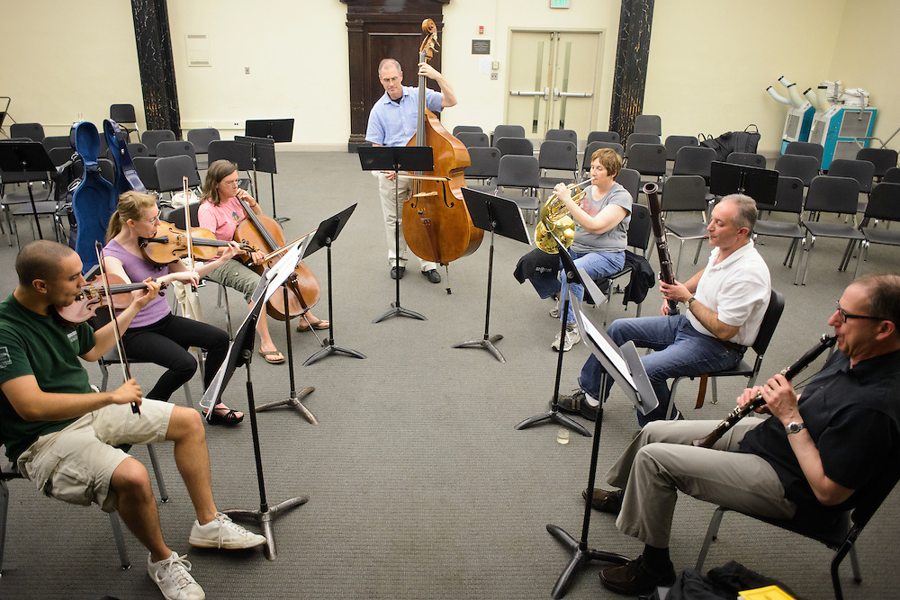 (photo by Matt Roth).Assignment ID: 30127886A..Participants in one of the BSO Academy's chamber music groups rehearses the Adagio -- Allegron con Brio section of Beethoven's Septet in E-flat Major, Op. 20 at the Baltimore School for the Arts Tuesday, June 26, 2012. Chamber group members are  (L-R) Matt DeBeal, violin student, Karin Brown, Baltimore Symphony Orchestra viola player, Peg Beyer, cello student, Bruce Rosenblum, bass student, Christina Barkan, French Horn student, Harry Kaplan, bassoon, and Bill Young, clarinet. ..
