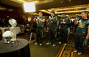 12//29/09  - The Oregon Ducks players take pictures of the Rose Bowl trophy on display during team media day Wednesday morning at the downtown L.A. Marriott.