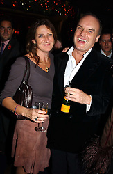 NICHOLAS COLERIDGE and  at a party hosted by Tatler magazine to celebrate the publication of the 2004 Little Black Book held at Tramp, 38 Jermyn Street, London SW1 on 10th November 2004.<br />