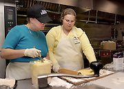 16215Diana Manchester & Janice Bailey make icing for a cake at the Atrium Cafe in Grover Center ..Faculty Member, Diana Manchester(left) & student Janice Bailey(right) make icing for a cake at the Atrium Cafe in Grover Center on 11/17/03