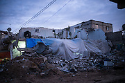 A hosue is been reconstructed with plastic sheets in northern Gaza streep