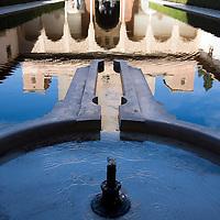 Reflected image of Torre de Comares and Patio de los Arrayanes, Alhambra, Granada, Spain