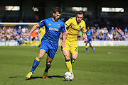 AFC Wimbledon defender Jon Meades (3) battles for possession with Bristol Rovers midfielder Billy Bodin (23) during the EFL Sky Bet League 1 match between AFC Wimbledon and Bristol Rovers at the Cherry Red Records Stadium, Kingston, England on 8 April 2017. Photo by Matthew Redman.