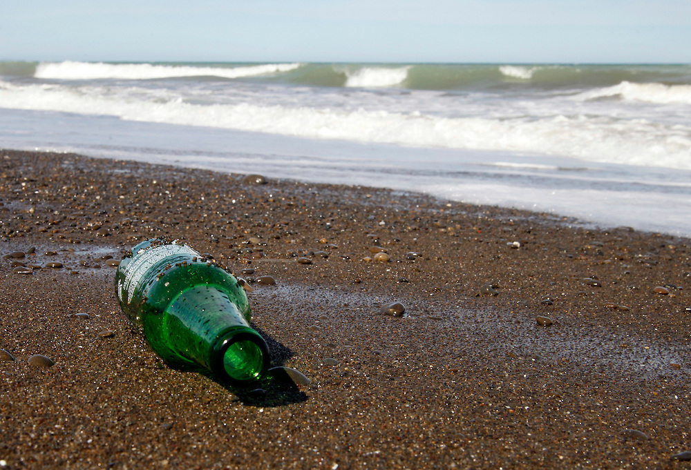 Bottle on the beach, North Canterbury, New Zealand, Wednesday, January 18, 2012.  Credit:SNPA / Pam Johnson