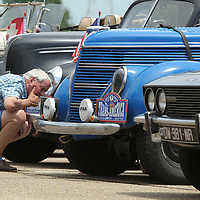 John Whitelock, from Wimborne Minster in England, looks over the steering components on his 1938 Ford Coupe during his stop at the Tupelo Automobile Museum on Friday morning. Whitelock is part of 39 cars taking part in The Endurance Rally Association's, The Trans America Challenge 2018. The rally started on May 27 in Charleston South Carolina and will end in Seattle on Sunday June 17. The drivers stopped in Tupelo for lunch, rest and a quick tour of the Tupelo Automobile Museum.
