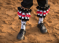 © Licensed to London News Pictures. 01/05/2017. Albury, UK. One of The Pilgrim Morris Men of Guildford wears socks decorated with tassels and bells as he prepares to dance at dawn on May Day on St Martha's Hill. Photo credit: Peter Macdiarmid/LNP
