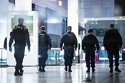 © Licensed to London News Pictures. 18/10/2019. Manchester, UK. Police search inside the Arndale Centre . Armed police and paramedics respond and the Arndale Centre and surrounding streets in Manchester City Centre are evacuated after reports of a man armed with a knife in the shopping centre . Photo credit: Joel Goodman/LNP