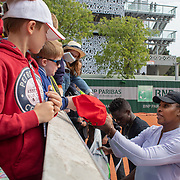 PARIS, FRANCE May 25. Serena Williams of the United States signing autographs for fans after a practice session on Court Five in preparation for the 2019 French Open Tennis Tournament at Roland Garros on May 2th 2019 in Paris, France. (Photo by Tim Clayton/Corbis via Getty Images)