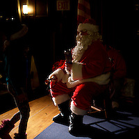 Santa Claus holds a present for a young girl in Philadelphia, PA December 16, 2016.
