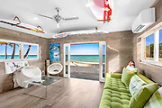 """Tommy Hilfiger Lists Colorful, Eye-Candy Estate for $27.5M<br /> <br /> 605 Ocean Blvd. in Golden Beach, FL, 33160, the home of internationally renowned fashion mogul Tommy Hilfiger and his wife Dee Hilfiger, for $27.5 million. <br /> <br /> The 14,079-square-foot beachfront estate is completely designed by acclaimed interior designer Martyn Lawrence Bullard to the Hilfigers' tastes, and features a design of art gallery/1960s/1970s style.<br /> <br /> Agents The Jills sold the estate to the Hilfigers in 2013.<br /> Boasting breathtaking direct ocean views and 100 feet of water frontage, the estate features seven bedrooms, eight bathrooms, four half bathrooms, and an elevator. Situated on a lush  27,500-square-foot lot, the estate offers a large oceanfront infinity pool as well as beautiful palms presiding over the private beach. It is one of a very small number of beachfront homes in exclusive Golden Beach, a luxury community home to many celebrities.  Additional property details include:<br /> Designed with a polychrome motif, the estate, featured in the September 2014 issue of Architectural Digest, is a palace of whimsical color, eclectic furnishings and vibrant Pop and post-Pop art.  <br /> The bright and airy estate welcomes with clean white walls and white-glass tiles, accentuated by a black marble central staircase. <br /> In the center of the home is the spacious living room, highlighted by a hair-on-hide carpet featuring vivid swirls. Black and white stripes don the kitchen floor.<br /> The bedrooms entice with bright and bold colors and patterns. Scratch-and-sniff fruit wallpaper covers the walls of several of the guest bathrooms.  <br /> Tommy's private office pays homage to the Hilfiger brand, with a montage of blue and red wall panels with white reveals. <br /> """"The Hilfigers had this estate designed to be a glamorous, sexy home where they could showcase their amazing collection of artwork, as well as incorporate a 'groovy,' colorful 1960s/1970s feel,"""" s"""