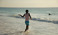 Local people frolicking in the sea on Pink Sands Beach, Harbour Island, The Bahamas