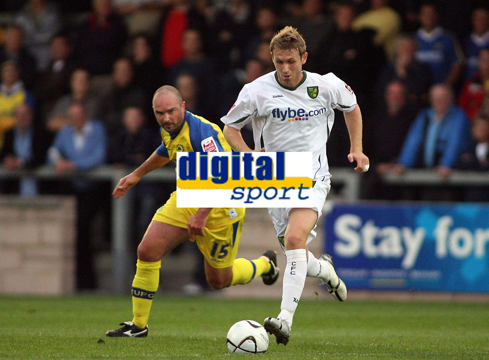 Photo: Rich Eaton.<br /> <br /> Torquay United v Norwich City. Carling Cup. 23/08/2006. Ryan Jarvis (right) of Norwich City attacks as Darren Garner of Torquay attempts to tackle