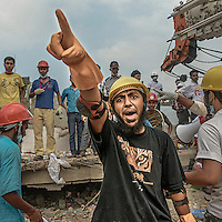 Mobarak Hossain, who volunteered with the Rana Plaza rescue team 3 weeks.<br /> <br /> He lived near Rana Plaza so while he was coming from his house to the Madrasa, he saw the building had completely crumbled.