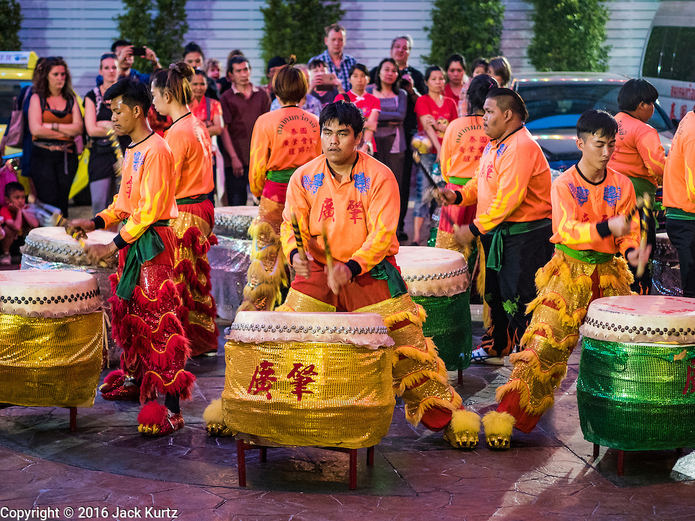 """08 FEBRUARY 2016 - BANGKOK, THAILAND:  Drummers perform for Chinese New Year's in front of a Chinese temple in Bangkok's Chinatown district during the celebration of the Lunar New Year. Chinese New Year is also called Lunar New Year or Tet (in Vietnamese communities). This year is the """"Year of the Monkey."""" Thailand has the largest overseas Chinese population in the world; about 14 percent of Thais are of Chinese ancestry and some Chinese holidays, especially Chinese New Year, are widely celebrated in Thailand.      PHOTO BY JACK KURTZ"""