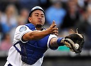 Catcher Miguel Olivo #21 of the Kansas City Royals makes a running catch during the third inning against the Baltimore Orioles at Kauffman Stadium in Kansas City, Missouri.
