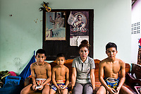 Kanlaya Chaiwarae and her three sons at their home in Rayong, Thailand.