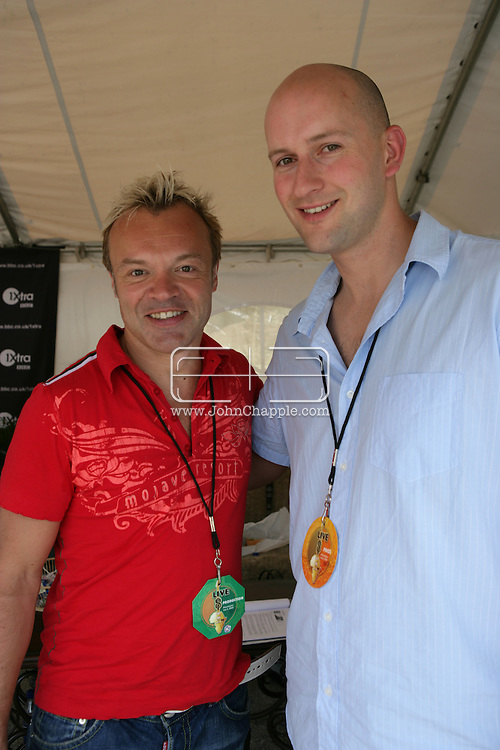 2nd July 2005, Philadelphia, PA. The USA Live 8 concert held in the city of Philadelphia. Pictured is Mirror reporter Ryan Parry with Graham Norton. PHOTO © JOHN CHAPPLE IN THE BIG APPLE. Tel (001) 212 397 7287.www.chapple.biz