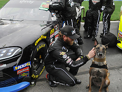 February 23, 2019 - Hampton, GA, U.S. - HAMPTON, GA - FEBRUARY 23: Jeffrey Earnhardt, Joe Gibbs Racing, Toyota Supra Extreme Concepts/ik9 (18) pets a Police K-9 before the Xfinity Series Rinnai 250 on February 23, 2019, at Atlanta Motor Speedway in Hampton, GA.(Photo by Jeffrey Vest/Icon Sportswire) (Credit Image: © Jeffrey Vest/Icon SMI via ZUMA Press)