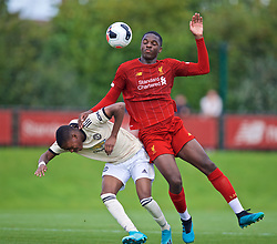 KIRKBY, ENGLAND - Saturday, August 31, 2019: Liverpool's Billy Koumetio (R) and Manchester United's substitute Deji Satona during the Under-18 FA Premier League match between Liverpool FC and Manchester United at the Liverpool Academy. (Pic by David Rawcliffe/Propaganda)