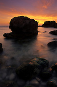 Near the town of Cascais, at Cape Raso, the sun sets the sky on fire as it descends below the horizon