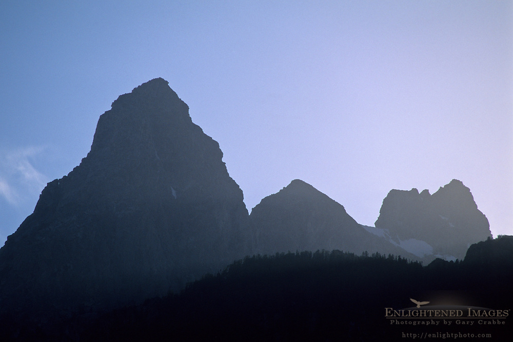 The Grand Teton backlit by late afternoon sun, Grand Teton Nat'l. Pk., WYOMING