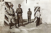 French and Moroccan soldiers by entrance gate to barracks Morocco 1930s