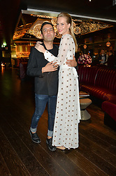 OSMAN YOUSEFZADA and POPPY DELEVINGNE at the Launch Of Osman Yousefzada's 'The Collective' 4th edition with special guest collaborator Poppy Delevingne held in the Rumpus Room at The Mondrian Hotel, 19 Upper Ground, London SE1 on 24th November 2014, sponsored by Storm models and Beluga vodka.