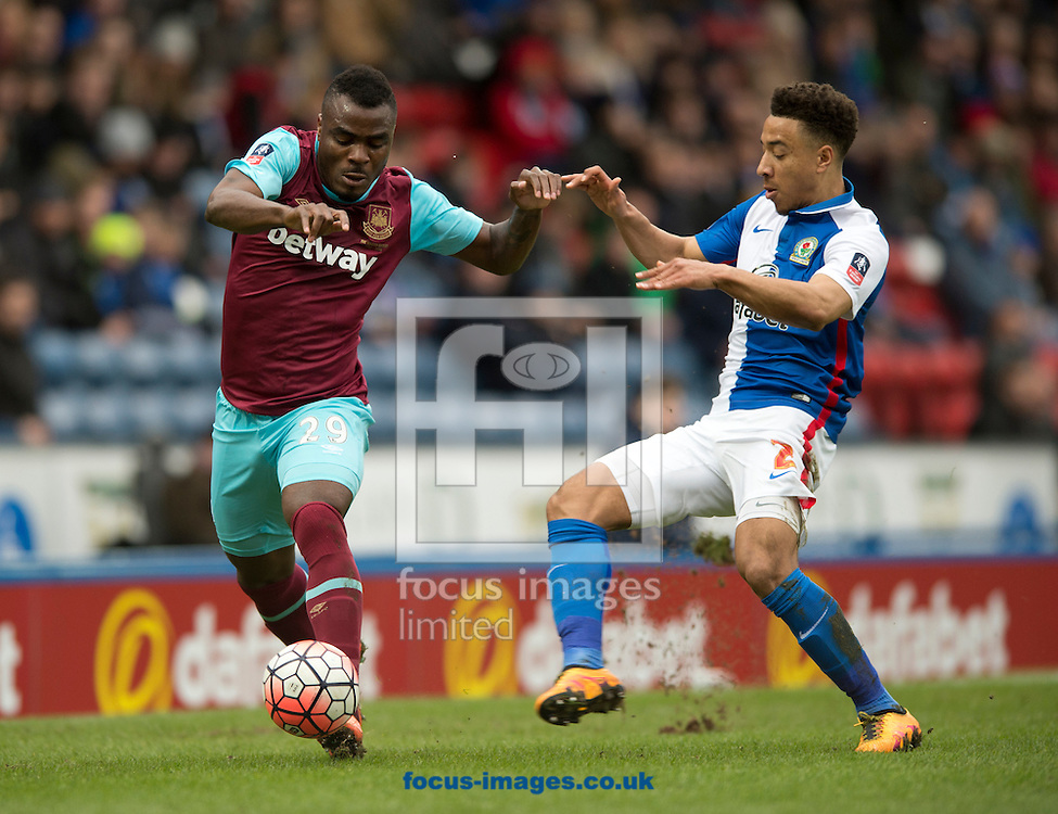 Emmanuel Emenike of West Ham United (left) gets past Adam Henley of Blackburn Rovers during the FA Cup match at Ewood Park, Blackburn<br /> Picture by Russell Hart/Focus Images Ltd 07791 688 420<br /> 21/02/2016